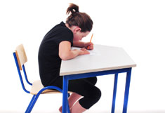 Student demonstrating poor posture while sitting in desk